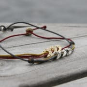 Coexista bracelets on a wooden surface